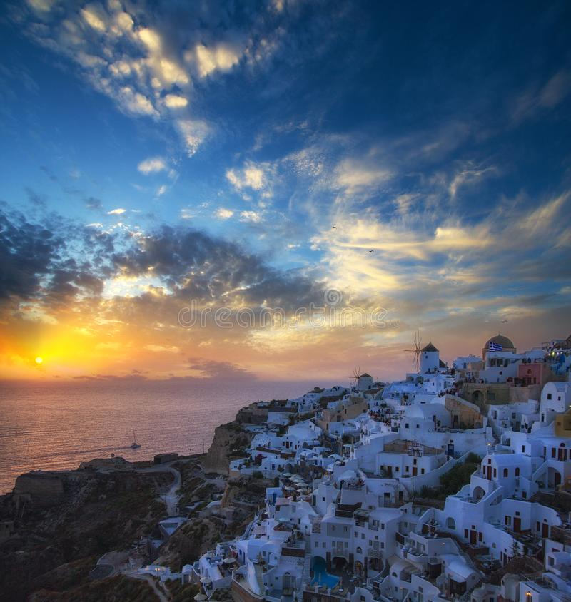 Blue and white colours of Oia City. Magnificent panorama of the island of Santorini Greece during a beautiful sunset in the Medite royalty free stock photos