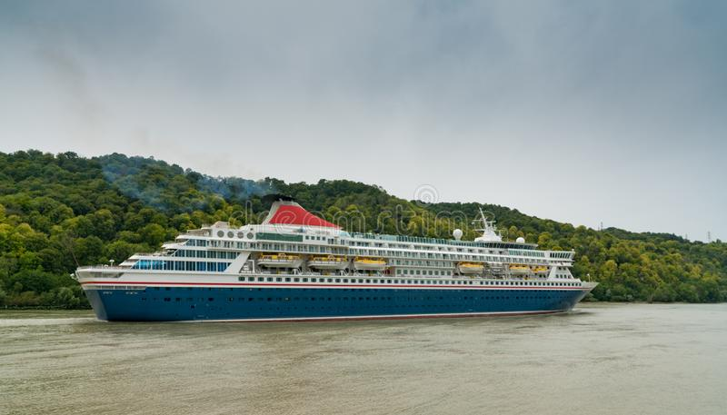 Blue and white cruise ship traveling along the Seine River from Paris to the English Channel stock photography