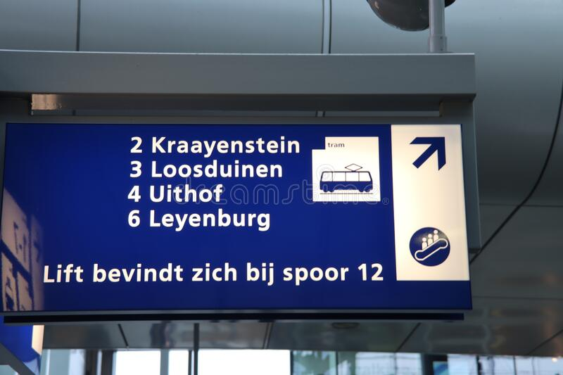 Blue and white direction sign to the street cars on Den Haag Central train station in The Hague stock photo