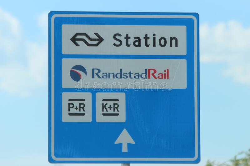 Blue and white direction sign to the train, bus and tram station Lansingerland Zoetermeer stock photo