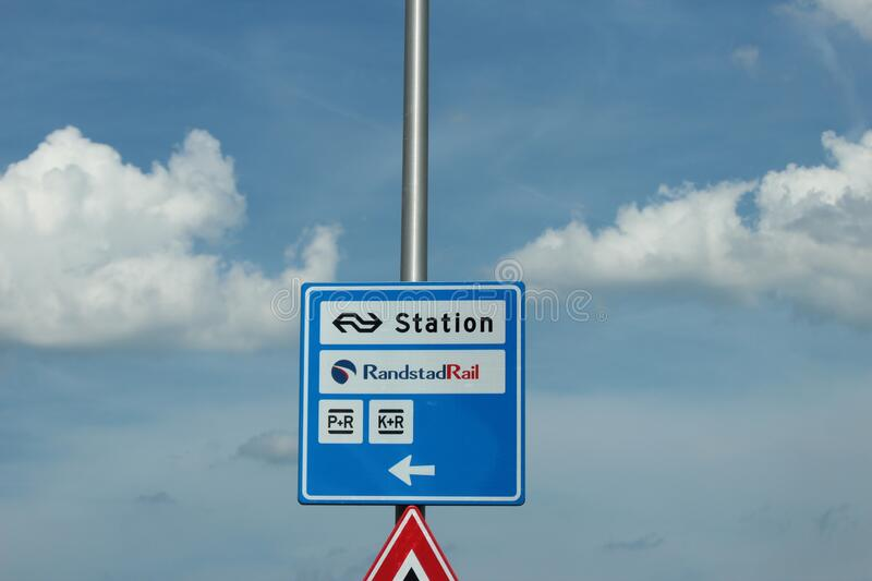 Blue and white direction sign to the train, bus and tram station Lansingerland Zoetermeer stock image