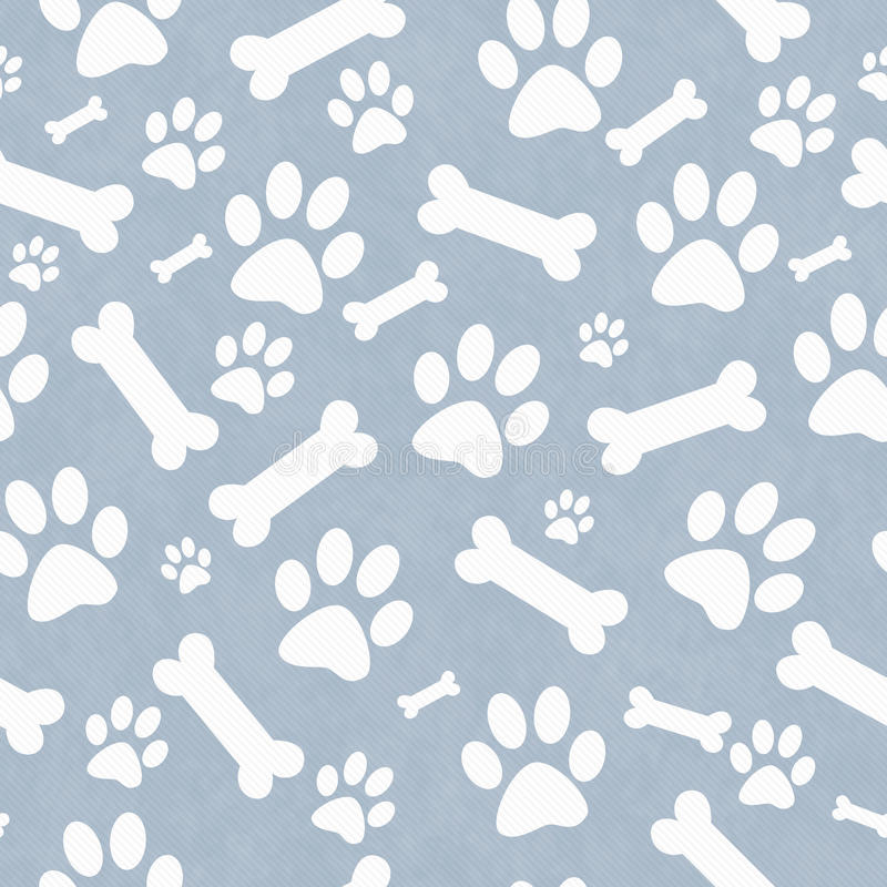 Blue and White Dog Paw Prints and Bones Tile Pattern Repeat Back stock photos