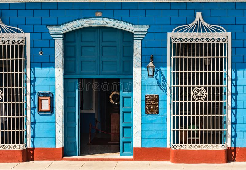 Blue and White Facade - Cuba. Sancti Spiritus , Cuba / March 15, 2017: Blue walls and white ironwork of exterior facade of Museo Provincial - Provincial Museum royalty free stock image