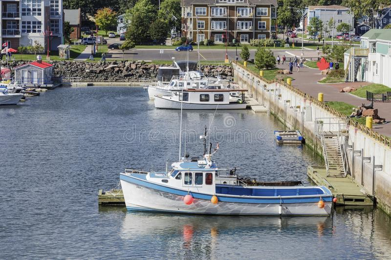 Blue and White Fishing Boat in Charlottetown. CHARLOTTETOWN, PRINCE EDWARD ISLAND - September 24, 2015: Charlottetown is the capital Canadian province of Prince royalty free stock photos