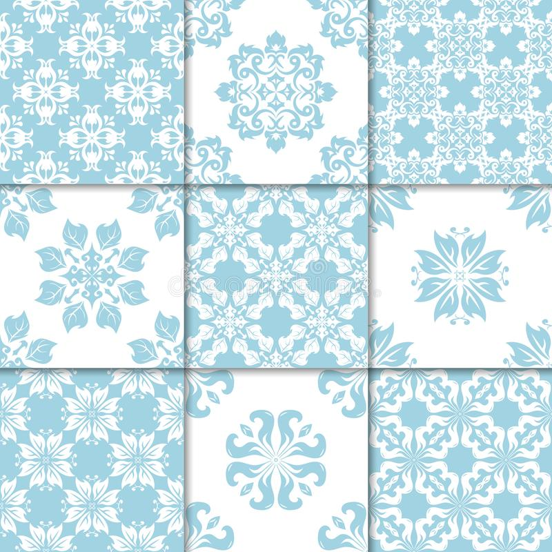 Blue and white floral ornaments. Collection of seamless patterns royalty free illustration