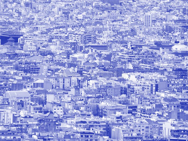 Blue and white futuristic duotone crowded urban cityscape background with hundreds of densely packed buildings. A blue and white futuristic duotone crowded urban stock photo