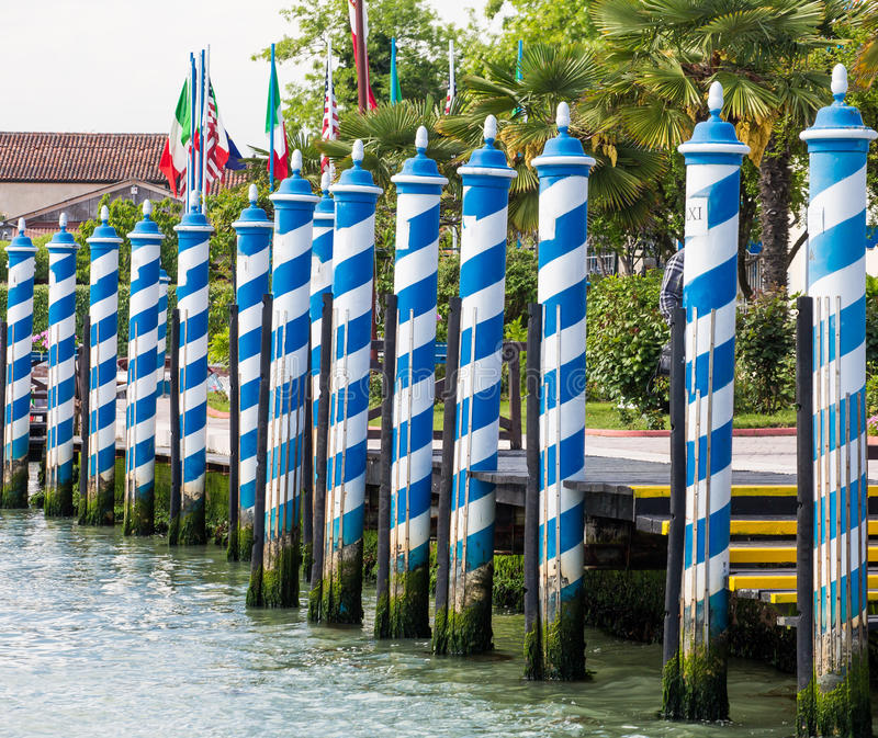 Blue and White Gondola Poles in Venice Canal stock images