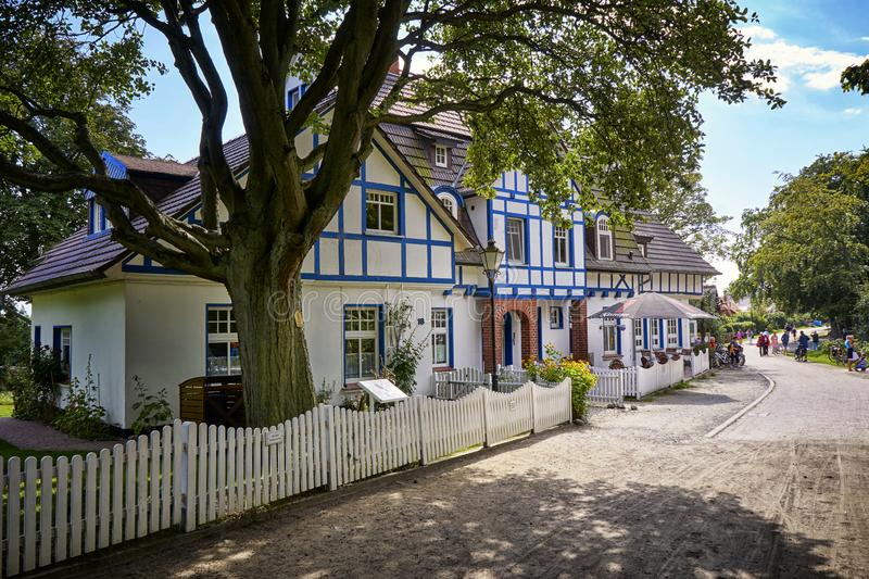 Blue and white half-timbered house on the island Hiddensee. Tourism, accommodation, amazing, vacation, ancient, street, awesome, view, beautiful, photo stock photography