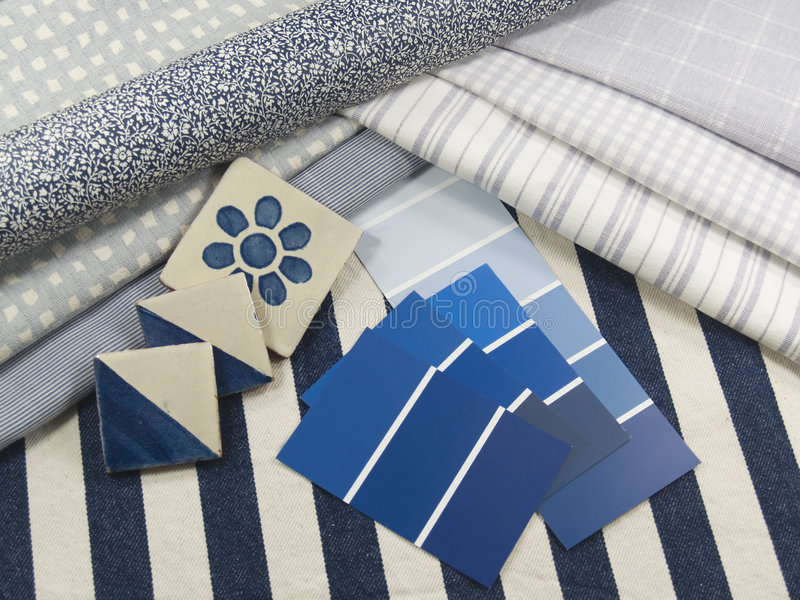 Blue and white interior design plan. Blue and white paint color swatches, fabric and wallpaper samples and ceramic tiles stock images
