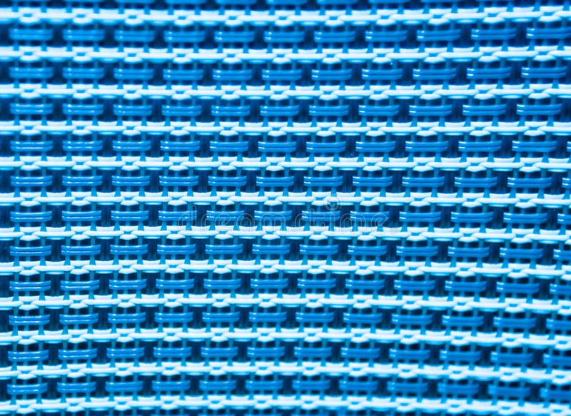 Blue and white knit plastic texture pattern background. Canvas wire stock photo