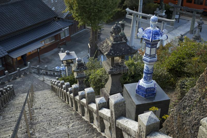 Blue and white lanterns near the stairs of the Tozan shrine in Arita at dusk royalty free stock image