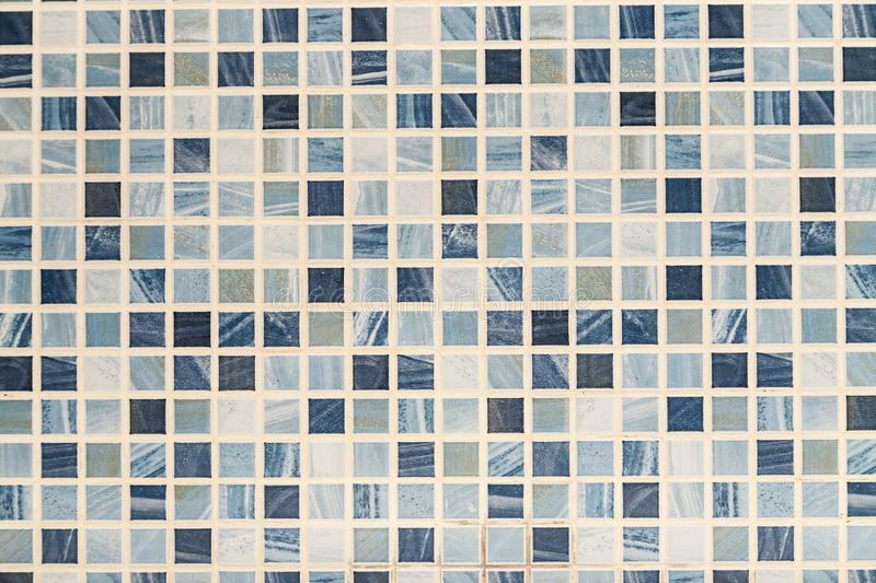 Blue and white mosaic tile background, abstract texture. Bathroom, ceramic, square, tiled, wall, backdrop, block, design, detail, geometric, surface, textured royalty free stock images