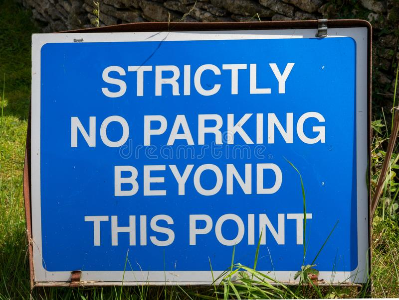 Blue and white No Parking sign stock photography