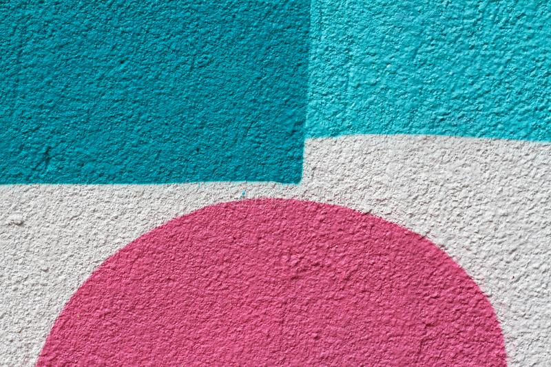 Blue and white painted wall with pink semicircle royalty free stock photo