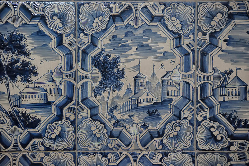 Blue white paintings on a tiled stove royalty free stock photo