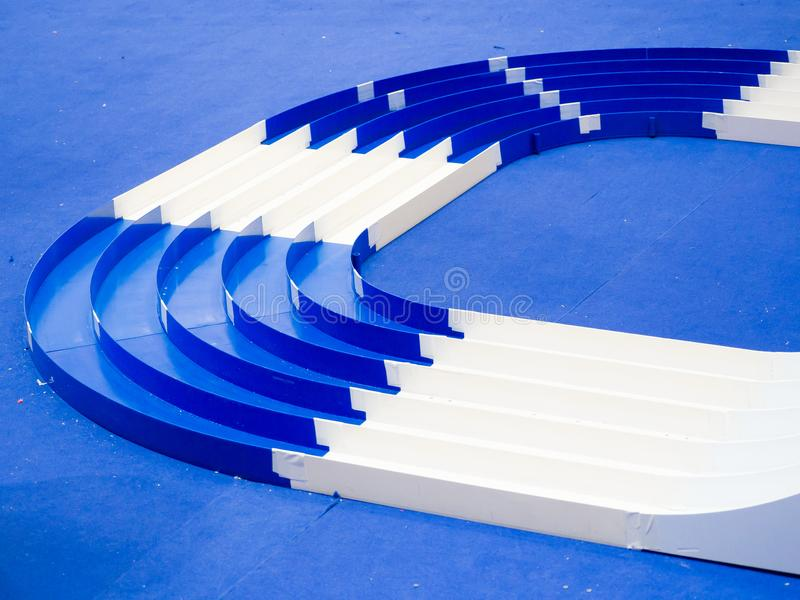 Blue and white pattern of Plastic,Model,Scale,Miniature racing car with 5 lane track. A blue and white pattern of Plastic Model Scale Miniature racing car with royalty free stock photo