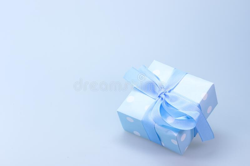 Blue and White Polka Dot Gift Box With Blue Ribbon stock photography