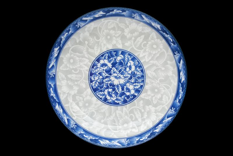 Blue and white porcelain of the flower pattern on dish isolated on black background. Above view.  royalty free stock images
