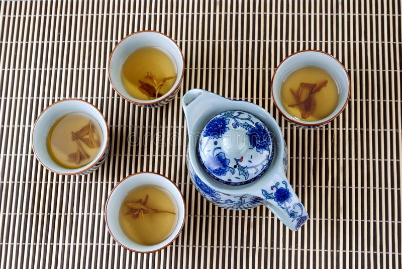 Blue and white porcelain teapot and teacups royalty free stock images
