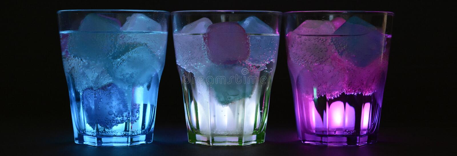 Blue White and Purple Beverage With Ice on Clear Drinking Glass royalty free stock image
