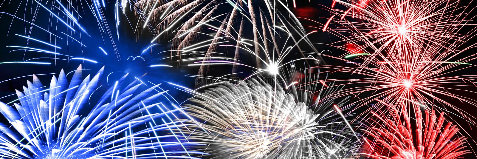Blue white and red fireworks panoramic background stock photography