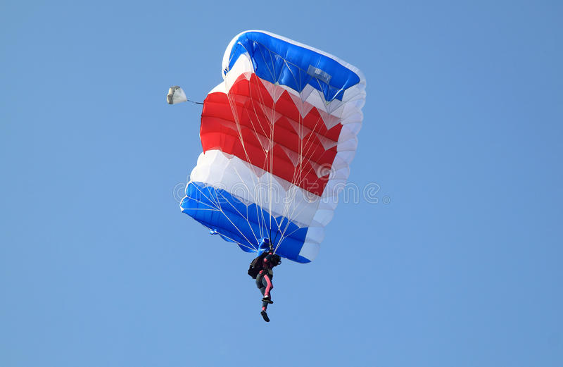 Blue white and red sail parachute stock images