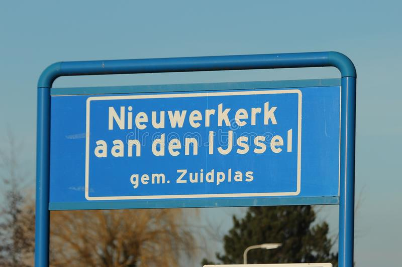 Blue and white sign to mark the start of the urban area in Nieuwerkerk aan den IJssel in the Netherlands. stock photography