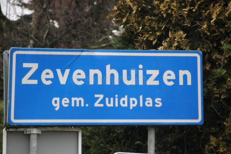 Blue and white sign to mark the start of the urban area in Zevenhuizen in the Netherlands. royalty free stock photo