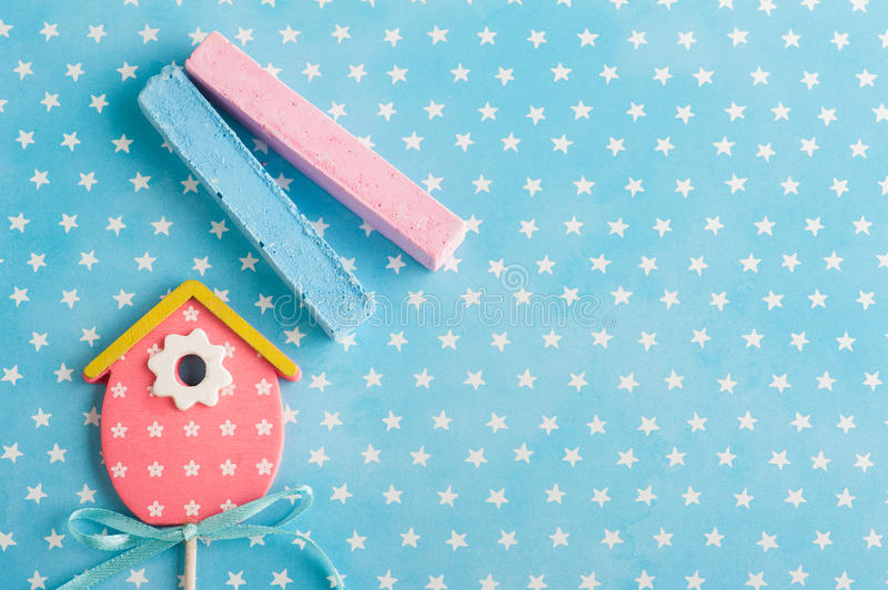Blue white stars background with pink bird house royalty free stock photos