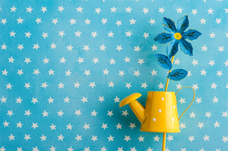 Blue white stars background with watering can stock photos
