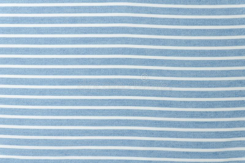 Blue and white striped seamless fabric.Close up.  royalty free stock photos