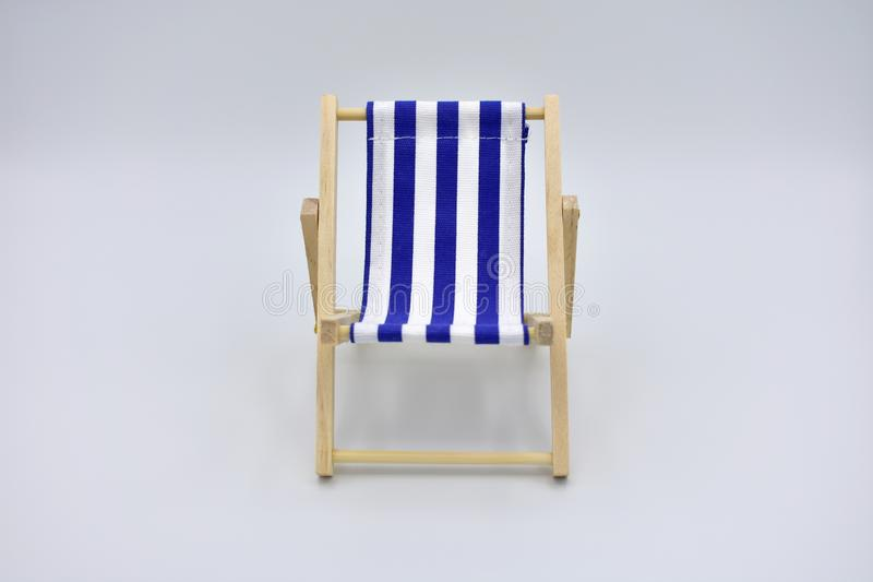 Sensational Blue And White Striped Umbrella And Beach Chair Stock Image Caraccident5 Cool Chair Designs And Ideas Caraccident5Info