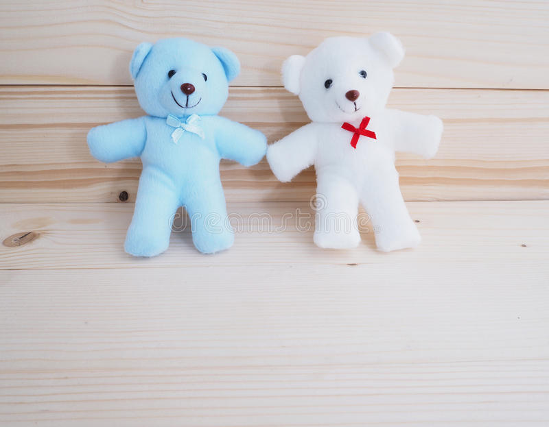 Blue and white toy teddy bear. On wooden background stock images