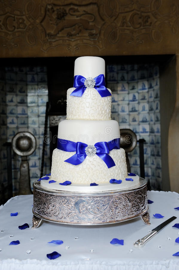 Blue and white wedding cake. At wedding reception stock photos
