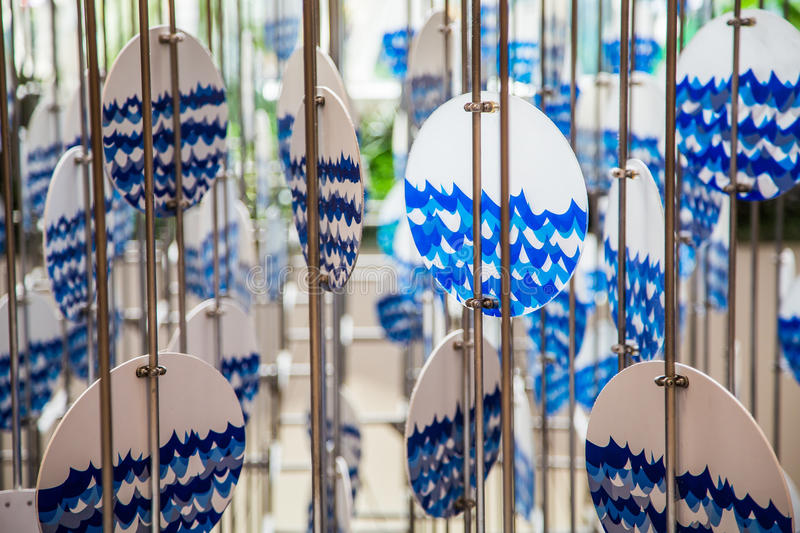 Blue and White Windchime. A blue and white wind chime with ocean or sea graphic stock photos