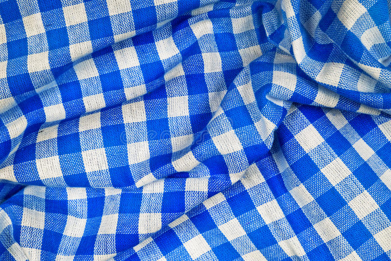 Blue and white wrinkled checkered Bavarian tablecloth. Blueand white wrinkled checkered Bavarian tablecloth pattern texture as Munich Octoberfest background stock photo