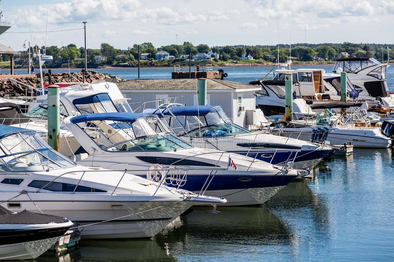 Blue and White Yachts in Marina. Fishing boats in harbor of Charlottetown, Prince Edward Island stock image