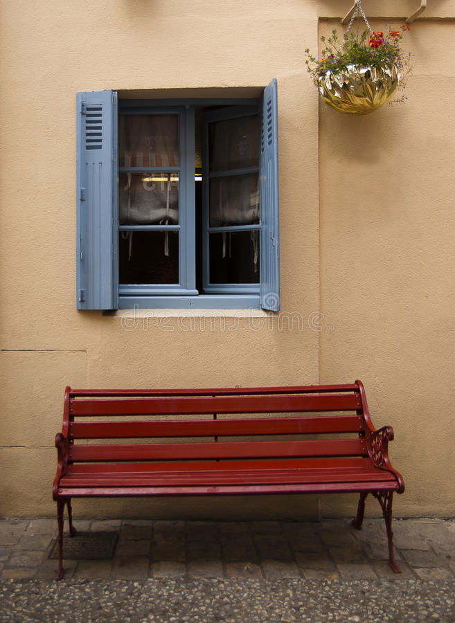 Blue window brown bench Brantome royalty free stock images