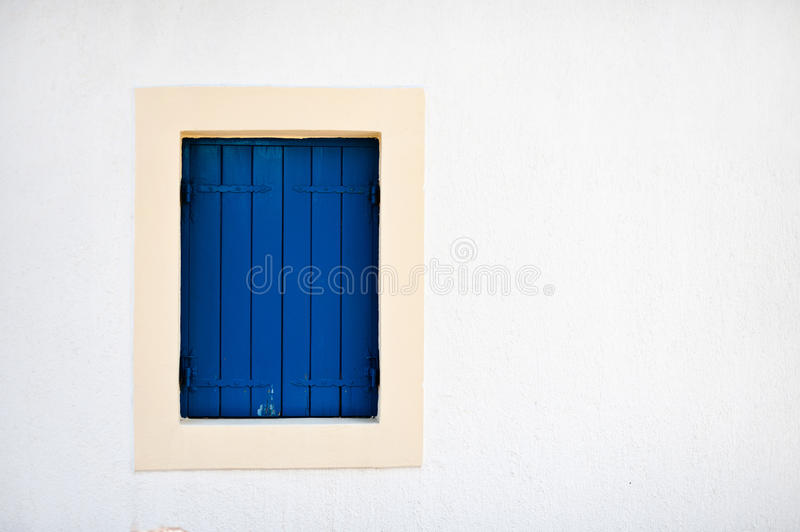 The blue window in the house stock images