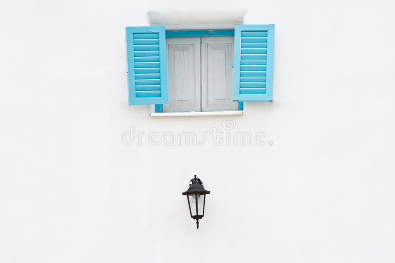 Blue window and lamp royalty free stock photo