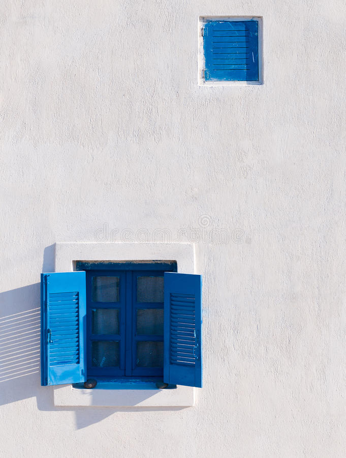 Blue window on white wall stock photo