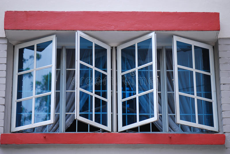 Blue Windows. A photo taken on some white rimmed blue window panes royalty free stock photography