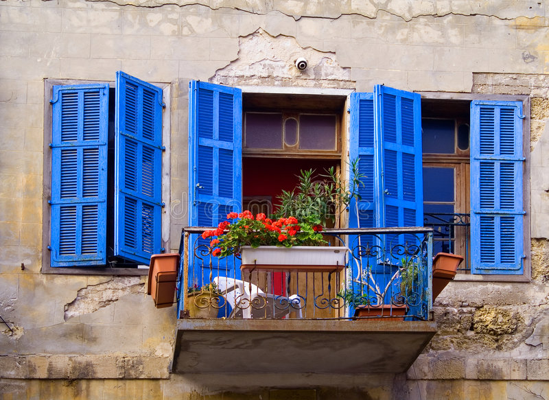 Blue windows Jaffa Israel. An old house with renew windows in Jaffa Israel stock photo