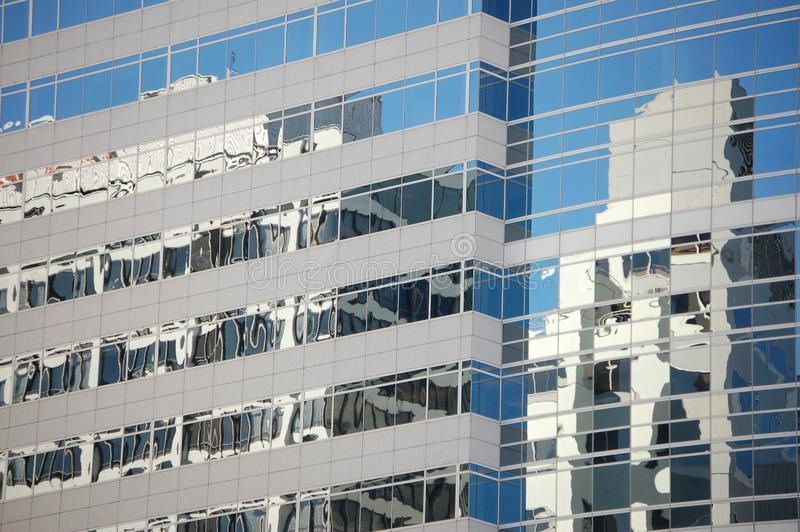 Blue windows mirror other buildings in Portland, Oregon. An office building`s blue windows reflect other office buildings in downtown Portland, Oregon stock image