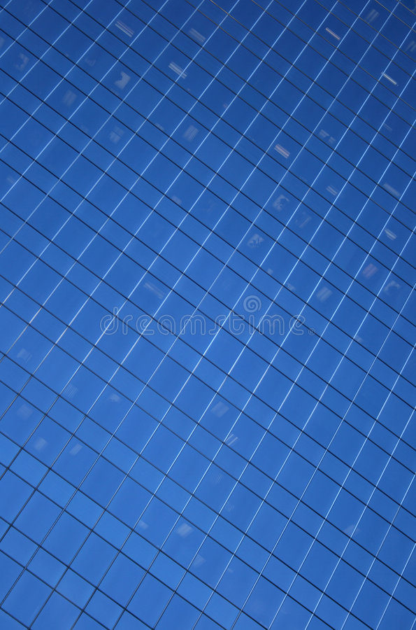 Blue windows pattern. Blue windows background. Windows of a skyscraper, forming a pattern royalty free stock photos