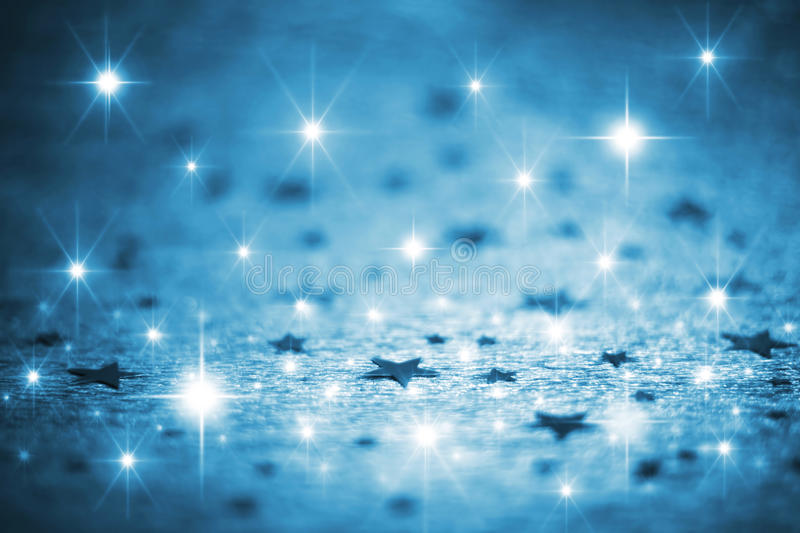 Blue winter background with stars royalty free stock image