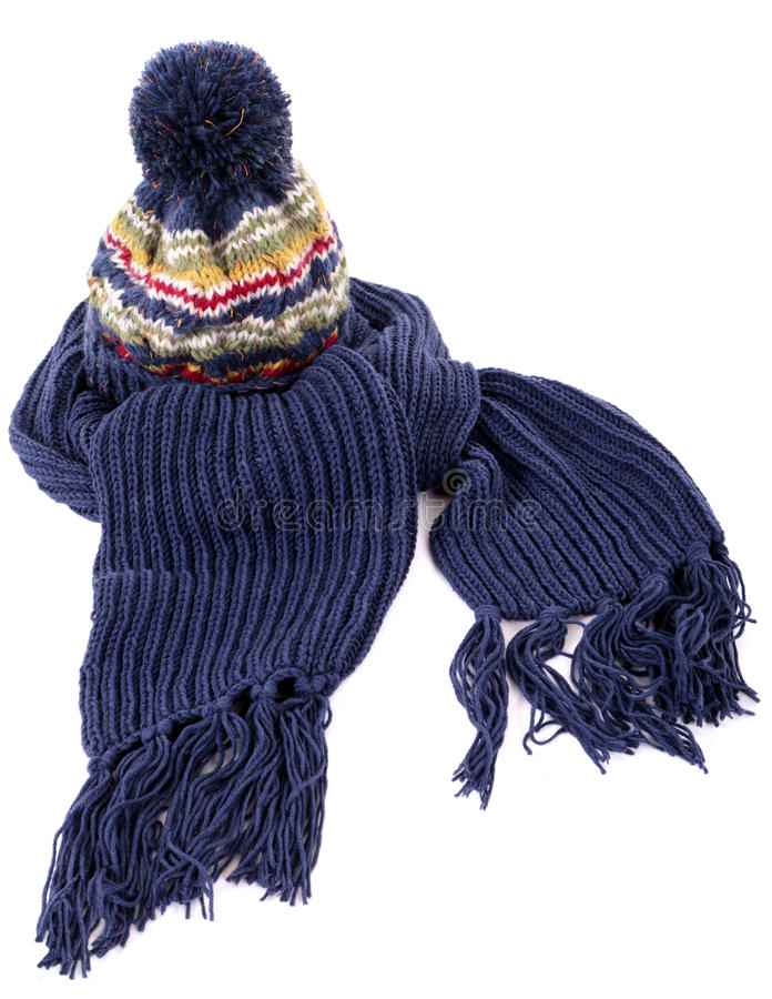 Blue winter scarf with knit hat isolated on white background. Blue winter bobble hat and matching scarf with tassels or fringe isolated against a white stock images