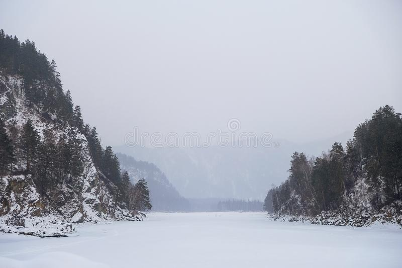 Blue winter mountain misty river. Snow frozen pine trees Idyllic landscape. Winter mountains natural view, sky, forest . Travel royalty free stock photos