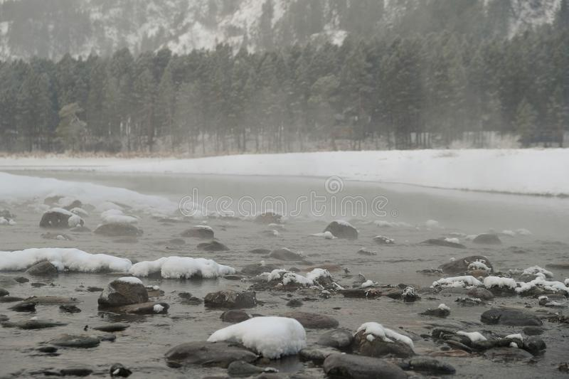 Blue winter mountain misty river. Snow frozen pine trees. Travel day Frost winter season stock photo