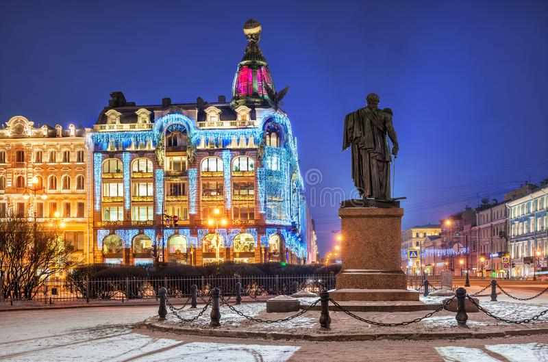 Blue winter night at Zinger's House. In New Year decorations and monument to Kutuzov royalty free stock photo